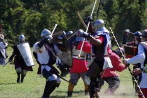 several heavy fighters in full armor fighting